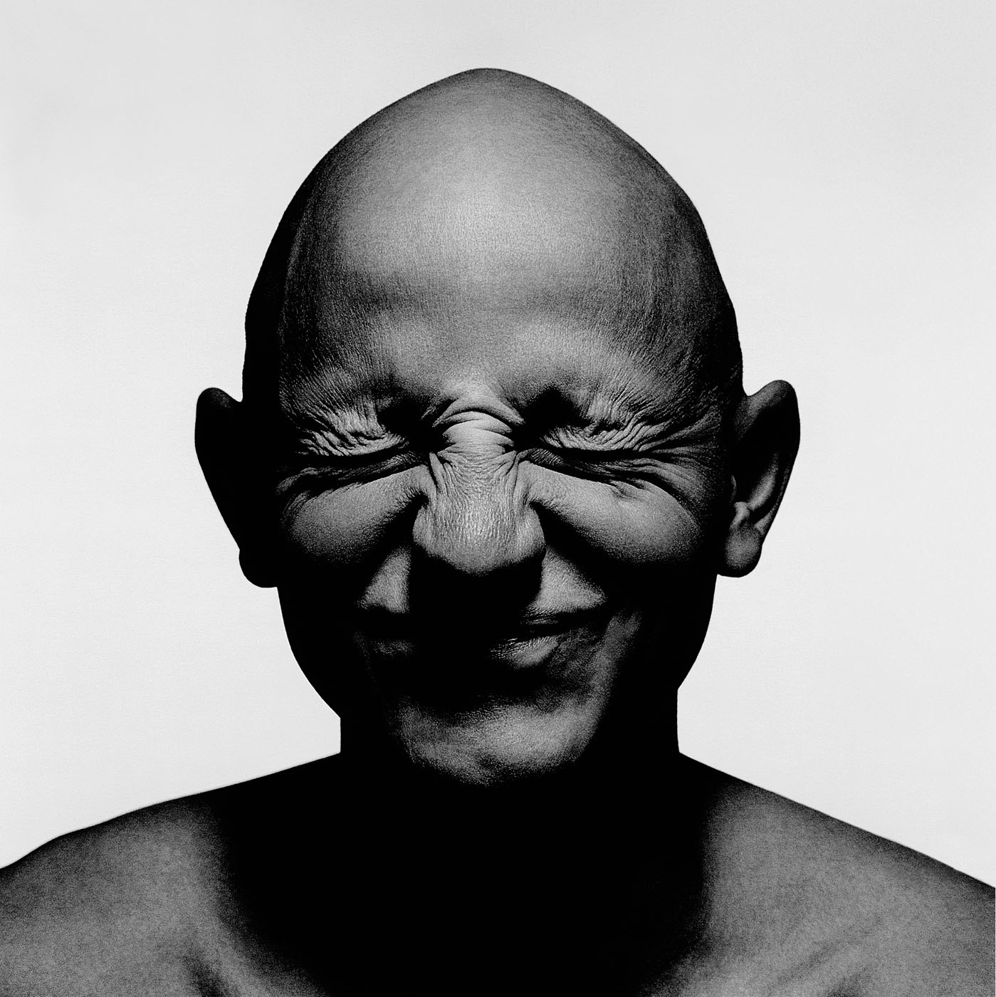 Portrait of bald male smiling by photographer Kenneth Rimm