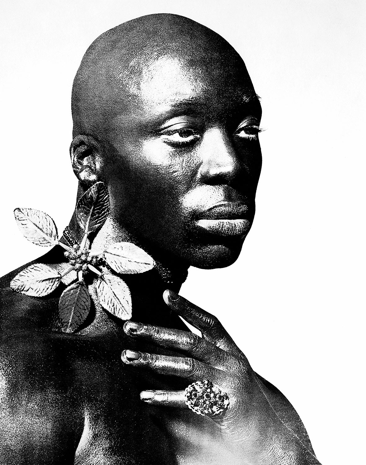 Black male portrait with jewellery by photographer Kenneth Rimm