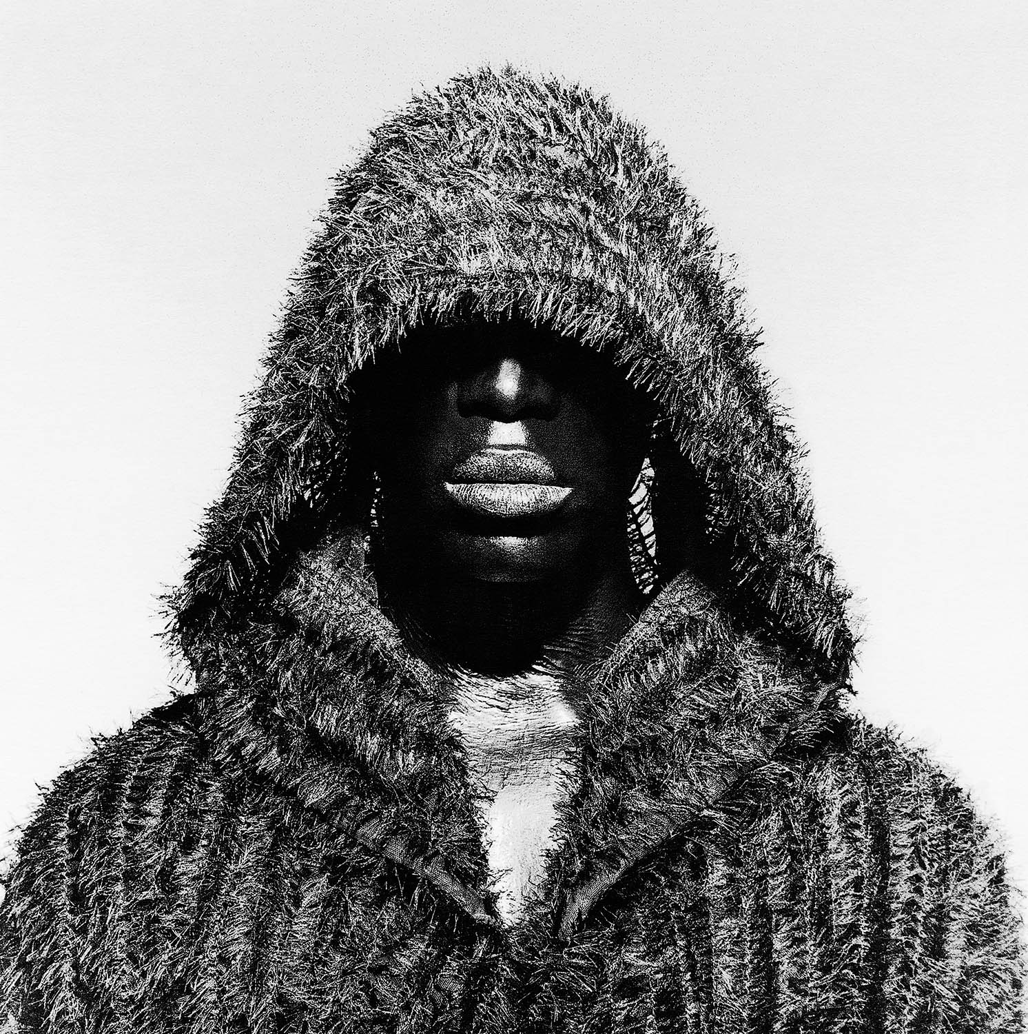 Black male portrait wearing hood by photographer Kenneth Rimm