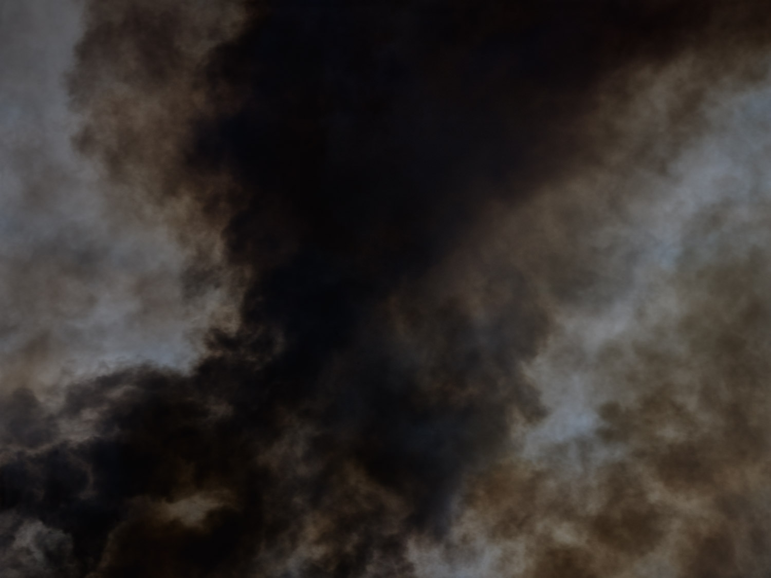Black smoke fire in the air by photographer Kenneth Rimm