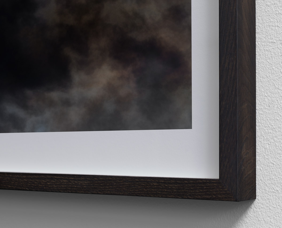 "Detail of ""Wildfire"" exhibition print framed in solid smoked oak."