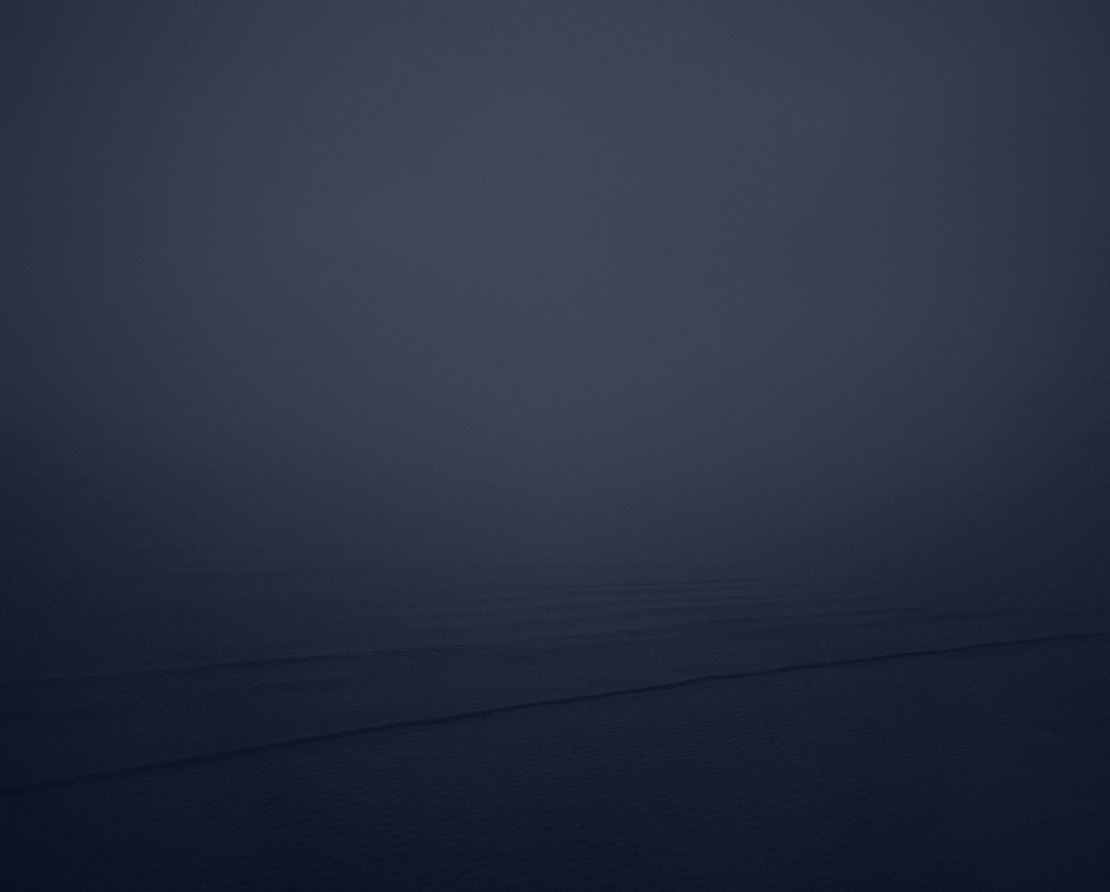 Misty dark seacape by photographer Kenneth Rimm.