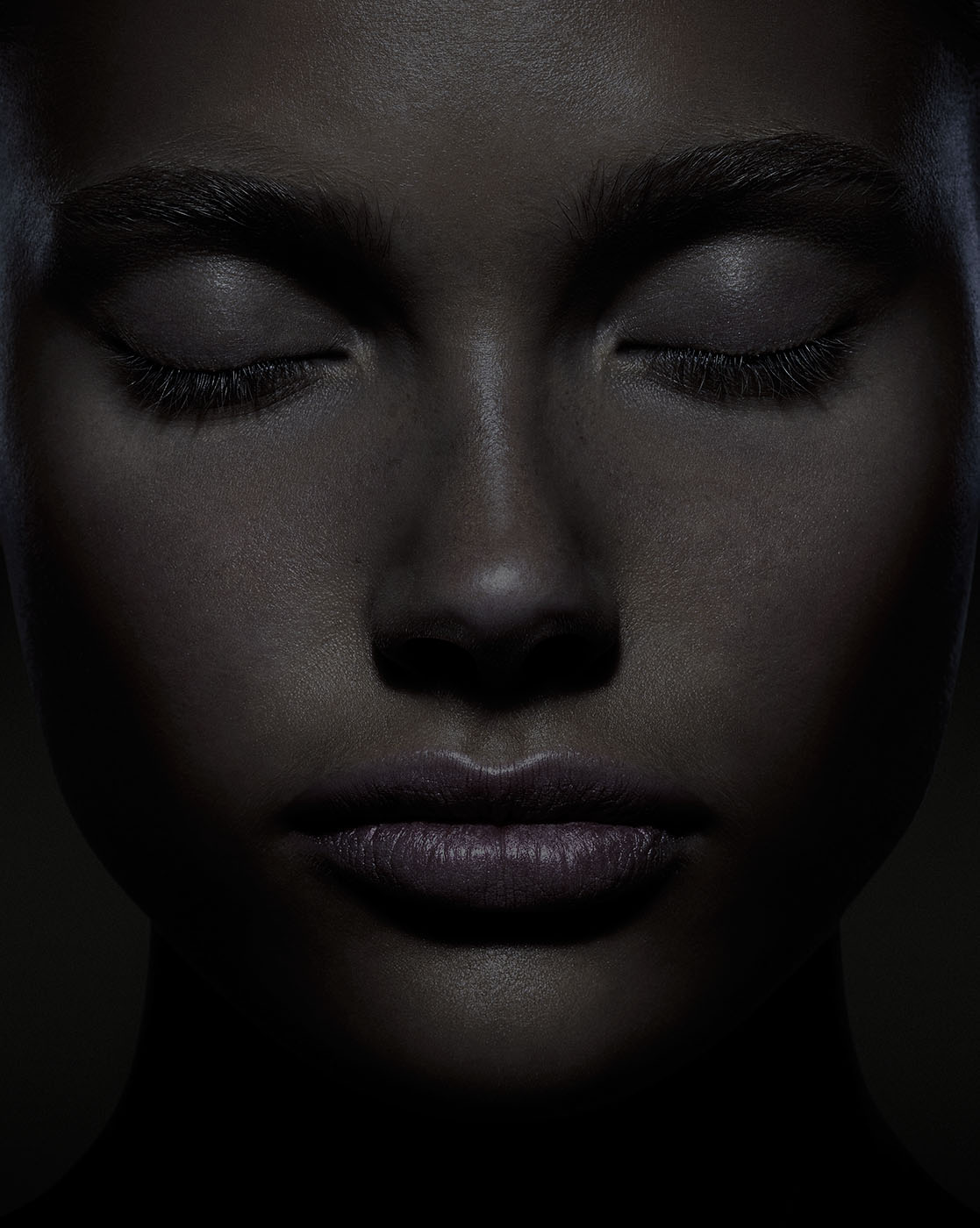 Dark female portrait with closed eyes by photographer Kenneth Rimm